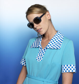 Woman with light blue dress and sunglasses, portrait - JL00197