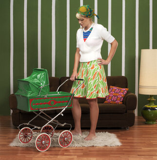 Woman with baby stroller - JL00170