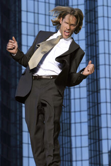 Young businessman jumping - KM00450