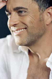 Mature man smiling, looking away - KM00315