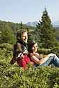 Young couple sitting in mountains - BABF00194