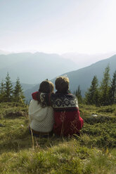 Young couple sitting in mountains - BABF00191