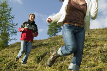 Young couple running in mountains - BABF00188