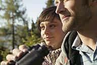 Young couple, man holding binocular - BABF00095