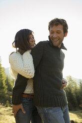 Germany, Bavaria, young couple embracing,  smiling - BABF00086