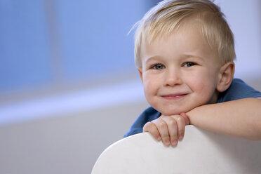 Boy (3-5) sitting on chair - SMOF00062