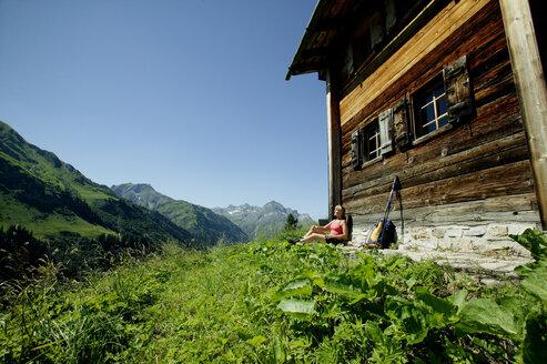 Woman resting at alp cottage - MRF00676