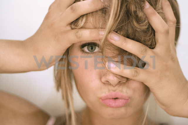 Young woman with hands in hair, close-up, portrait - MFF00280