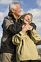 Senior couple, man embracing woman - WESTF03489