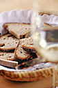 Bread basket and glass of wine - WESTF03800