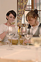 Two women testing wine - WESTF03794