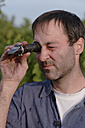 Man using refractometer - WESTF03782