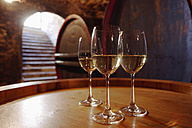 White wine in glasses on wine cask, close-up - WESTF03776