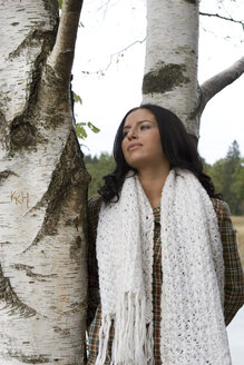 Young woman standing by tree - LDF00364