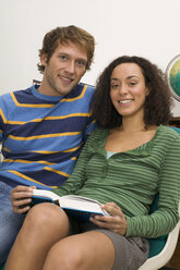 Young couple, woman holding book - WESTF03696