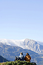 Couple in mountains, watching summits - HHF01108