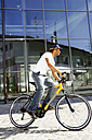 Germany, Bavaria, man riding bicycle, side view - FFF00710