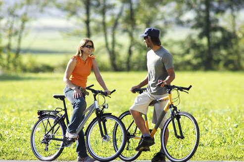 Germany, Bavaria, couple riding bicycle - FFF00707
