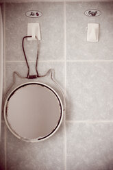 Mirror on hook, close-up - DW00032