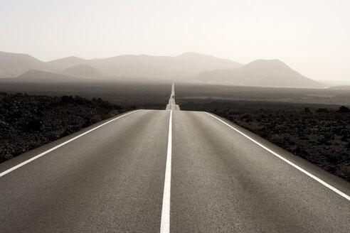 Spain, Lanzarote, empty road through landscape - ABF00134