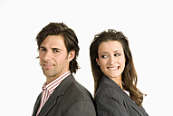 Two businesspeople standing back to back - WESTF04702