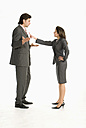 Businessman and businesswoman discussing, side view - WESTF04696
