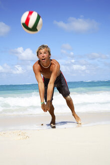 Young man playing volley ball on beach - PKF00005