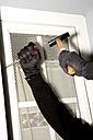 Burglary,hand with gloves on window, close-up - MAE00305