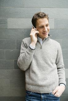 Man using a mobile phone - NHF00452