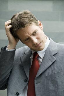 Businessman musing - NHF00419
