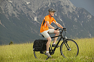 Cycling across a meadow - MRF00886