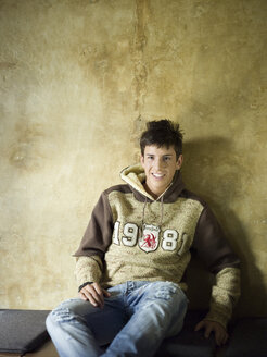 Young man leaning on wall - KMF00866