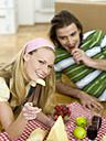 Couple having break in new flat - WESTF05239