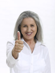 Senior woman making hand gesture, thumbs up - WESTF05400