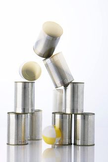 Throwing a ball into a pyramid of cans, close-up - THF00546