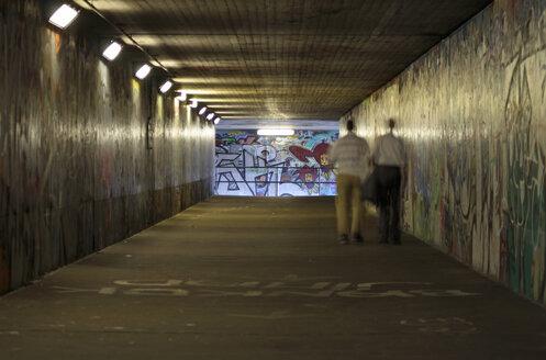 Men walking across undercrossing - TLF00166