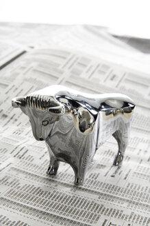 Bull figurine on journal, close-up - PKF00198