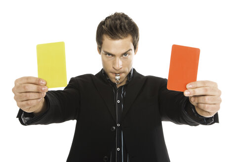 Young man holding red and yellow card close-up - PKF00171