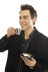 Young man holding coffe cup, close-up - PKF00150