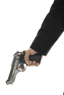 Young man holding hand gun, close-up - PKF00144