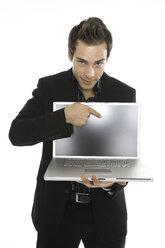 Young man holding laptop, close-up - PKF00129