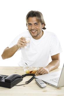 Man at desk drinking water, close-up - PKF00120