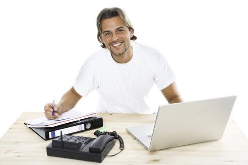 Man at desk with folder, laptop and phone, close-up - PKF00117
