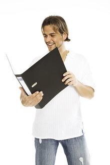 Man holding folder, close-up - PKF00108
