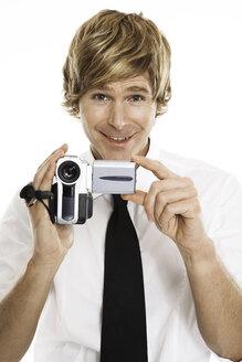 Man holding digital camera, close-up - PKF00090