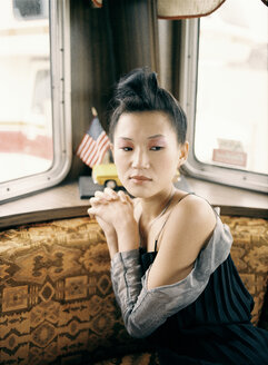 Asian woman in van, portrait - PK00216