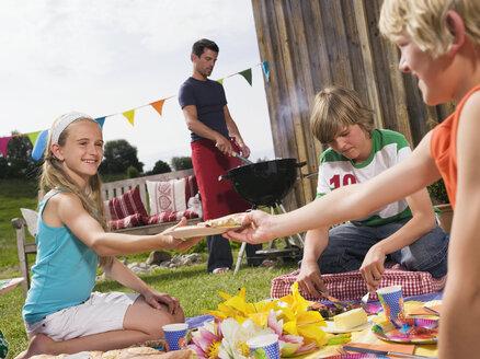 Family in garden, having barbecue - WESTF06071