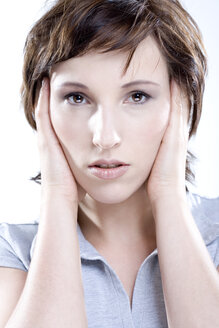 Woman shutting ears, portrait - MAEF00491