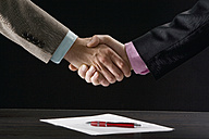 Business colleagues shaking hands, mid section - CLF00462