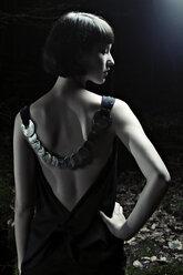 Woman wearing evening dress, rear view - DW00108